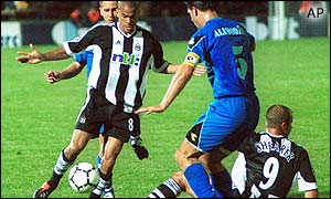 Newcastle midfielder dribbles through the Zeljeznicar defence