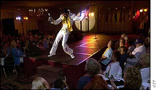 Dennis Stella of Calumet City, Illinois, performs during the Images of the King Tribute at the Holiday Inn Select Hotel 14 August 2002 in Memphis, Tennessee