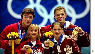 Elena Berezhnaya and Anton Sikharulidze of Russia and Jamie Sale and David Pelletier of Canada with gold medals following the Salt Lake City judging scandal