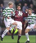 Neil Lennon (left) in action for Celtic