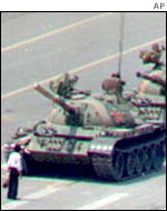 A protester blocks the way of tanks heading for Tiananmen Square in 1989