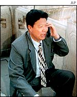 A Chinese man makes a call on a mobile phone