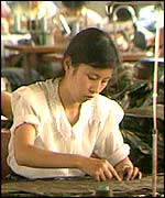A woman works in a sewing factory in 1991