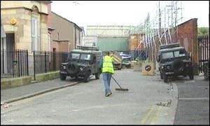 Workers clear up after another night of violence