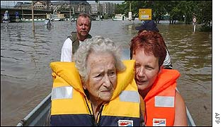 Elderly woman being evacuated
