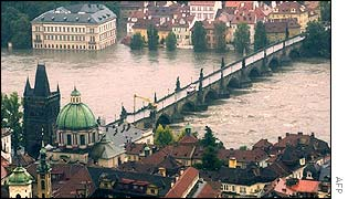 The receding waters of the River Vltava provide respite to the evacuated residents of Prague