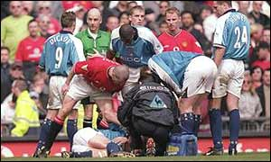 Roy Keane tells Alf Inge Haaland what he thinks after tackling him in the Manchester derby in 2001