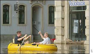 People paddle in a boat in the Mitte district of Dresden