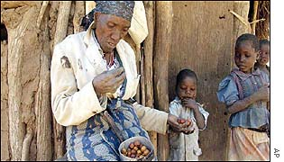 Woman eats masau wild fruit