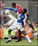 Blackburn's Dwight Yorke and Sunderland's Phil Babb compete for the ball