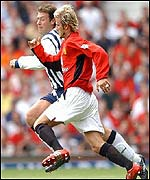 West Brom's Sean Gregan takes on David Beckham of Manchester United