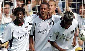 Rufus Brevett, Steve Marlet and Louis Saha celebrate Marlet's penalty