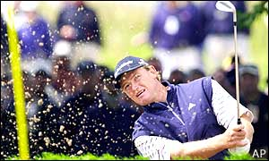 Ernie Els plays out of a bunker on the first hole in his third round