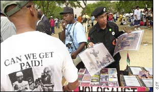 Members of the New Black Panther Party sell prints of early 20th century lynchings at the rally