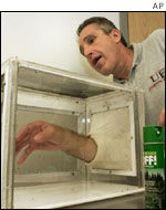 Dr Jonathan Day of the University of Florida demonstrates the effects of insect repellent
