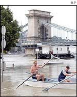 People use a rowboat after the Danube flooded its banks in Budapest
