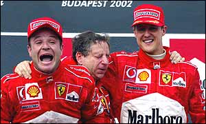 Rubens Barrichello, Ferrari sporting director Jean Todt and Michael Schumacher on the podium at the Hungarian Grand Prix