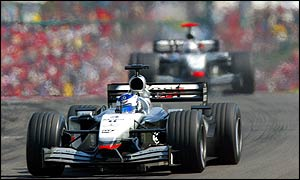 KImi Raikkonen leads David Coulthard during the Hungarian Grand Prix
