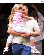 Father holds child close in Soham