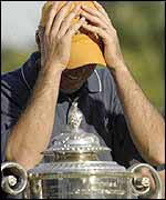 Rich Beem holds his head in his hands after winning the USPGA