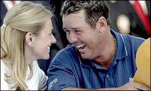 Rich Beem laughs with his wife after winning the USPGA