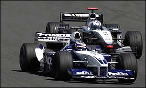 Juan Pablo Montoya and David Coulthard fight for track position at the Nurburgring