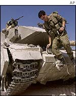 An Israeli soldier on an army tank