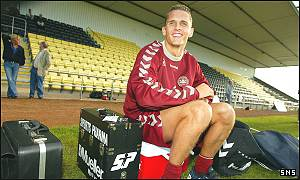 Peter Lovenkrands rests during training at Dumbarton's Strathclyde Homes Stadium