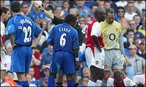 Aliou Cisse gets his marching orders from referee Mike Riley