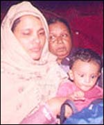 Tasleem Murad (l) with her infant son