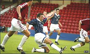 Peter Canero slots home the equalising goal for Scotland
