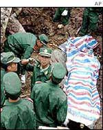 Chinese rescuers at the scene of a landslide