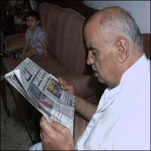 Abu Nidal's brother, Mohammed al-Banna, reads of his death in a newspaper