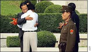 Ri Kyong-song hugs a North Korean official