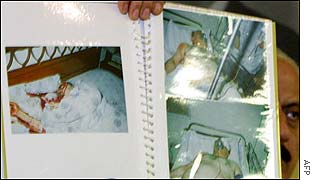 Iraq security chief shows pictures of Nidal in hospital