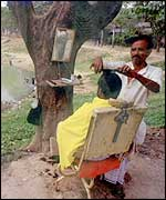 An Asian barber under a tree