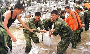 Chinese soldiers laying sandbags