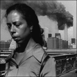 Briton Lucille Blair turns her back on the burning twin towers on September 11