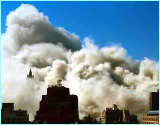 As the towers collapse, a huge cloud of dust covers the city