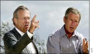 President Bush (R) and Defence Secretary Donald Rumsfeld
