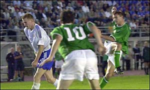 Robbie Keane looks on as Colin Healy hits Ireland's second goal