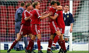 Denmark's Ebbe Sand is congratulated by team-mates after putting his side ahead