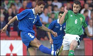Northern Ireland's Damien Johnson (right) and Cyprus defender Petros Fon in action at Windsor Park