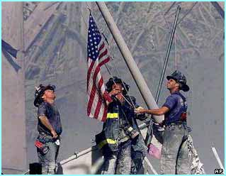 Firemen found a flag in the rubble and rigged it up on a girder, to stand as a symbol