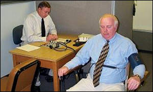 Virginia state police official administering polygraph test