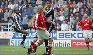 Newcastle striker Lomana LuaLua scores in a Premiership game against Charlton