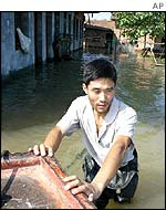 Man pushing boat