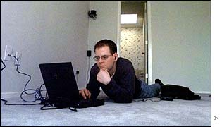 Man using laptop in empty room