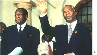 Robert Mugabe, left, with Thabo Mbeki, South Africa's president