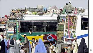 Buses loaded with belongings of returnees